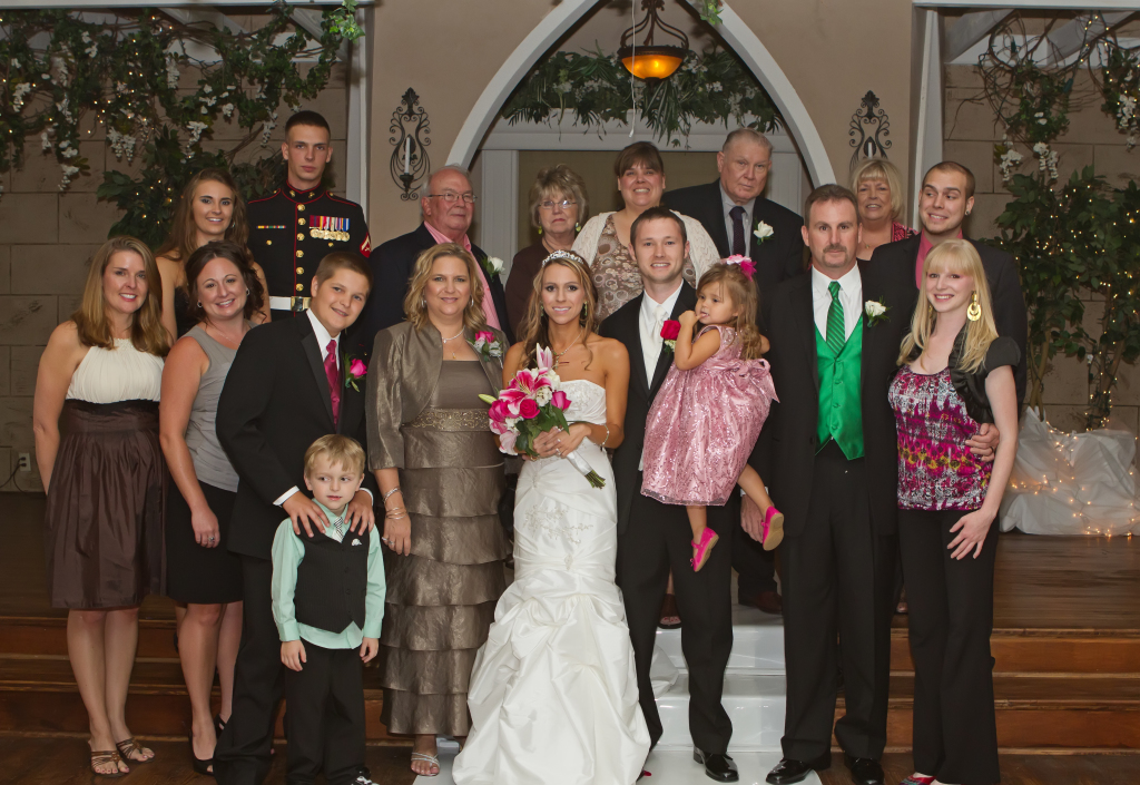 Lisa at her daughter's wedding with her husband, children, grandchildren, parents, sisters, nieces, nephews and in-laws.