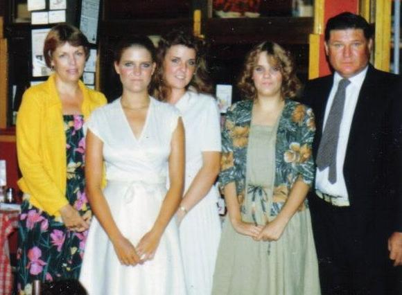 Lisa at age 19, with her parents and sisters